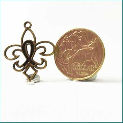 filigree metal charm